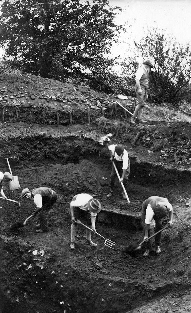 Spoil from the Iron Age ditch, cutting IV, so deep being removed in four stages, Hembury, Devon 1930